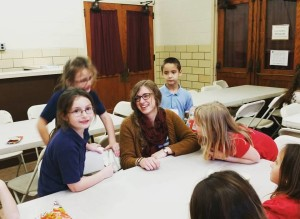 Eliza with students at Elementary Club